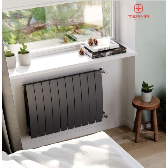 TERMA Camber vodní radiátor pod okno - v interiéru